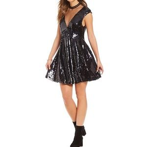 Free People flirty black sequin dress size med